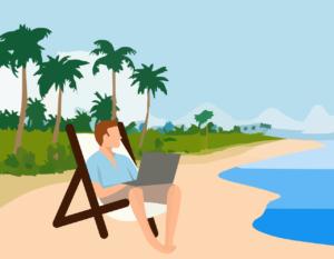 Mann mit Laptop am Strand